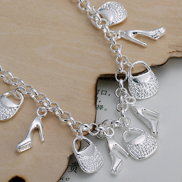 Silver chain bracelet with charms
