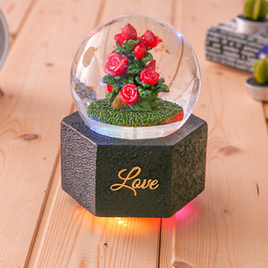 Custom 2018 resin flower water globe music color changing led lights crystal snow globe water ball big size garden snow globes