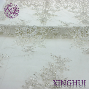 Wholesale hand made luxury beaded embroidery white bridal lace fabric