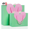 Heart-shaped high-end clothing gift handbag kraft paper bag