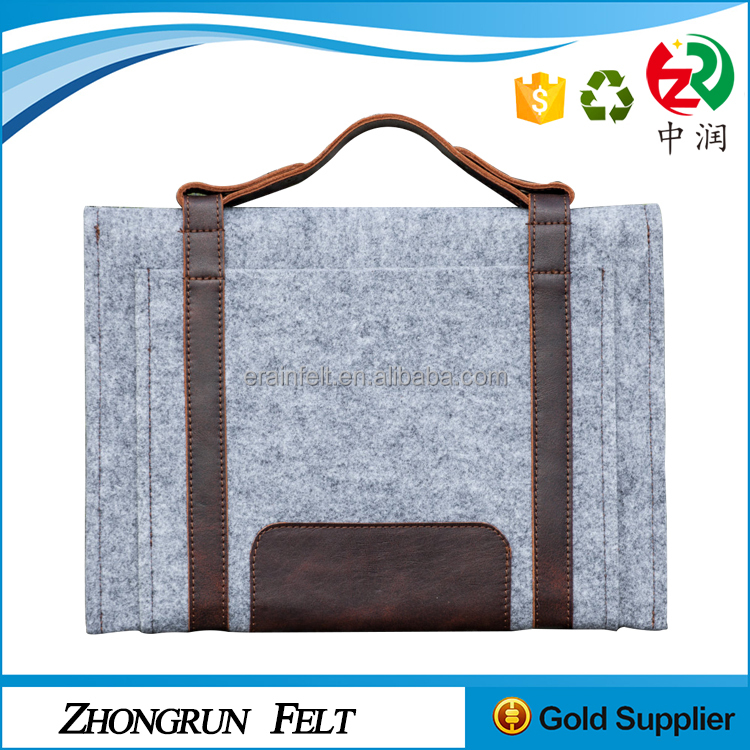 Alibaba wholesale portable handmade 13 inch felt <strong>laptop</strong> sleeve with leather handle