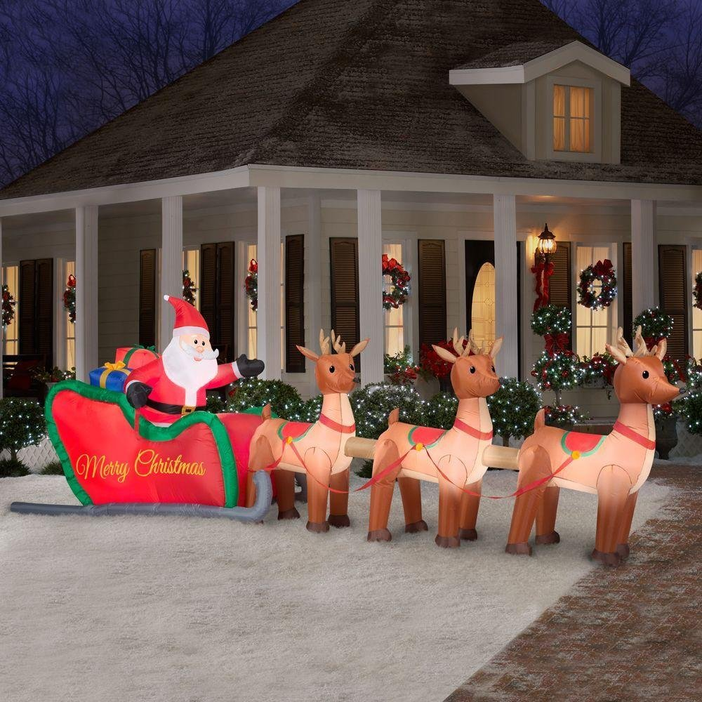Home Accents Holiday Christmas Decorations 16 ft. W Inflatable Santa in Sleigh with Reindeers