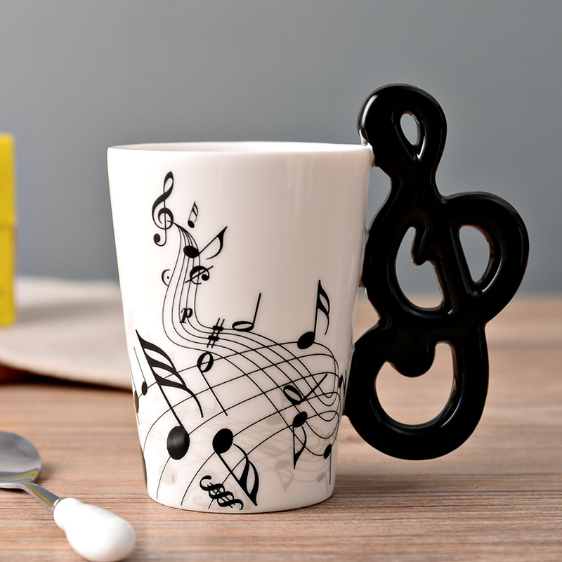 Alibaba.com / HT300016 Hot Sale Novelty Art Ceramic Mug Cup Musical Instrument Note Style Coffee Milk Cup Christmas Gift Home