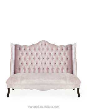 High Wing Back On Tufted Sofa