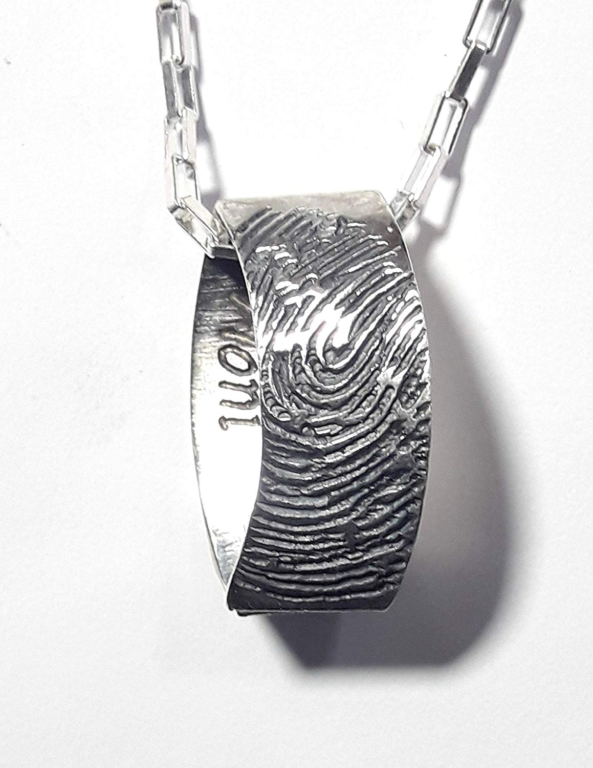Sterling silver, memorial necklace, memorial pendant, with fingerprint, apparently flattened ring with personalized text.