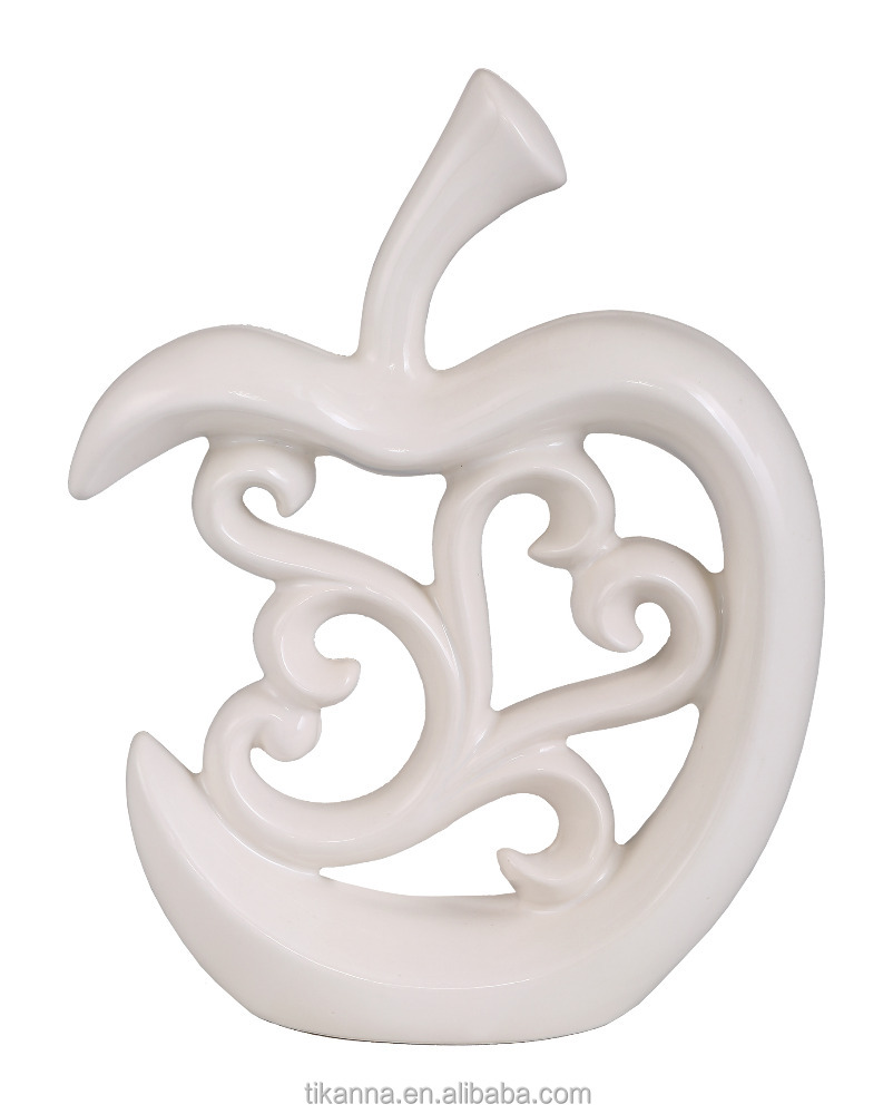 white apple shaped ceramic decorative article