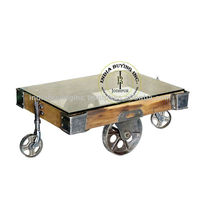 industrial cart coffee table glass top