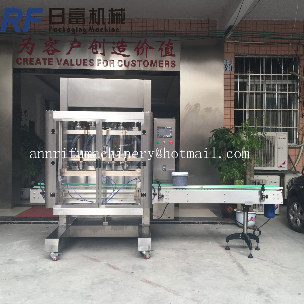 4 heads beer bottling machine drinking water filling equipment