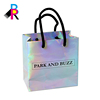 /product-detail/cheap-custom-size-fashionable-laser-holographic-paper-bag-ribbon-colorful-shopping-paper-bag-with-logo-printing-60818916786.html