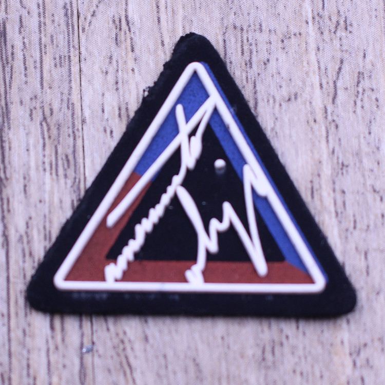 Eco-friendly rubber custom made iron on silicone logo patch