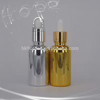 Cosmetic cylinder 30ml gold essential oil glass bottle with gold silver dropper