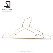 Multifunctional metal hanger for wet clothes