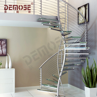 morden round stair case with glass treads