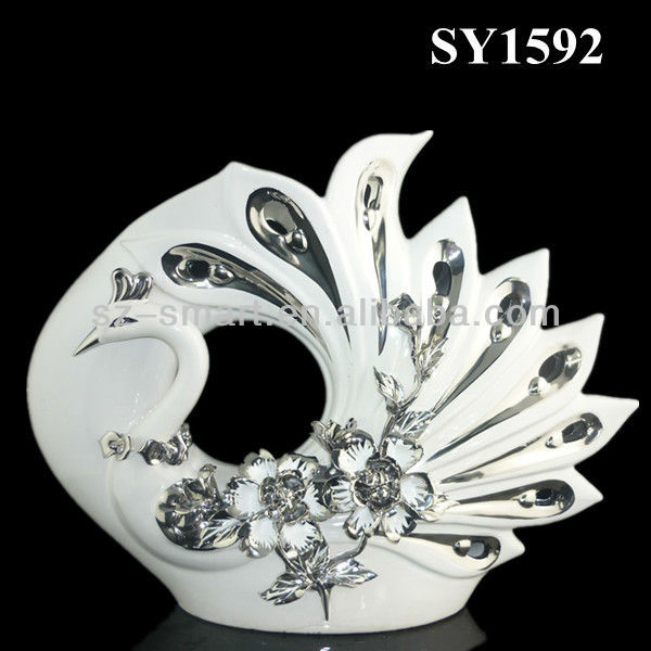 Isolate the silver plating bird animal figurine ceramic statue