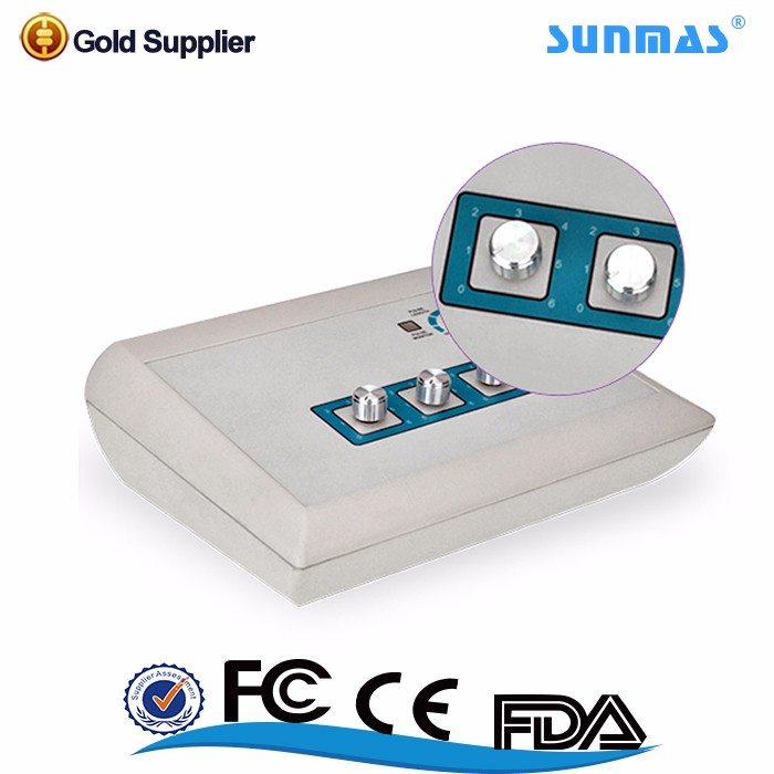 Sunmas AID tens unit on knee