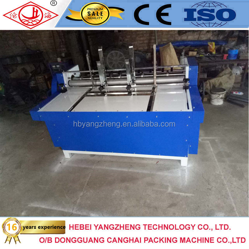 Corrugated partition slotter machine for making a cardboard partitions