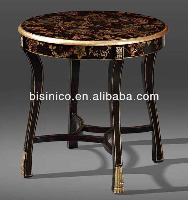 antieke woonkamer zwart& goud kleur tafel in het midden, bloemen ...