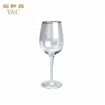 Crystal wine glasses with gold rim for party