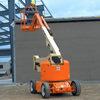 Articulating boom vehicle lift, articulating table telescopic boom lift