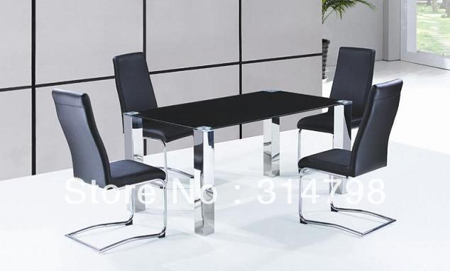 Glass dining table with stainless steel legs, leather