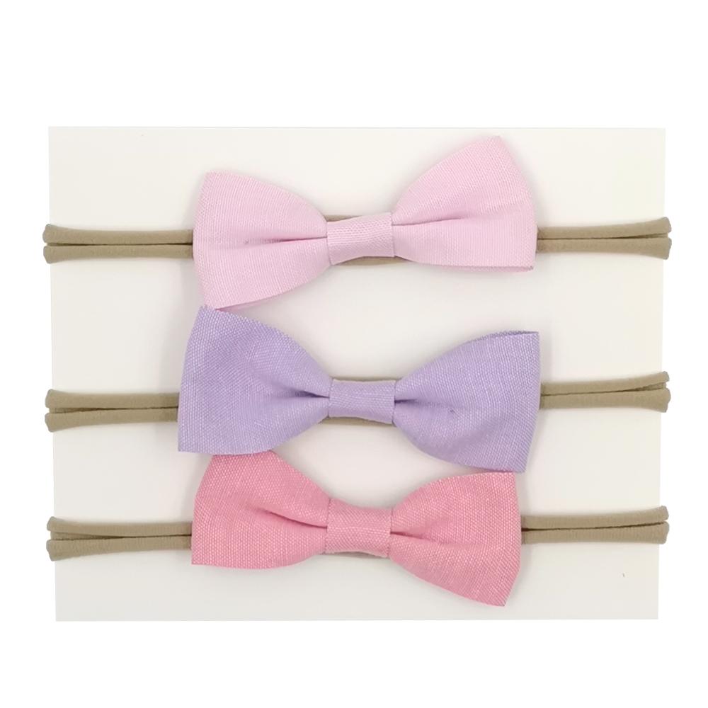 a3f6cce1a747 Hermosa a la ligera bebé elástico corbata de lazo de tela diademas para  vacaciones