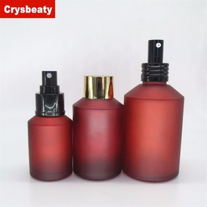 Hot sale red spray lotion glass bottle with screw cap