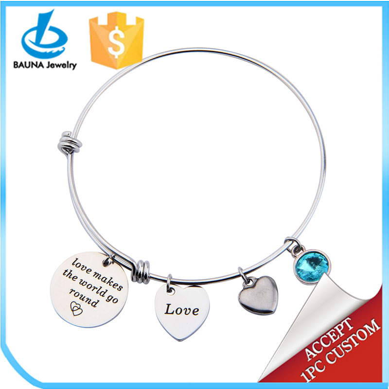 Hand stamped Love makes the worlds go round bracelet