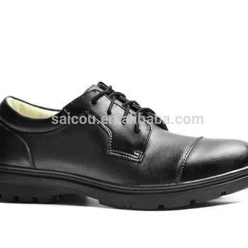 Man Dress Shoes And Police Officer