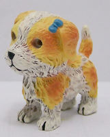 small yellow resin dog garden or indoor decor
