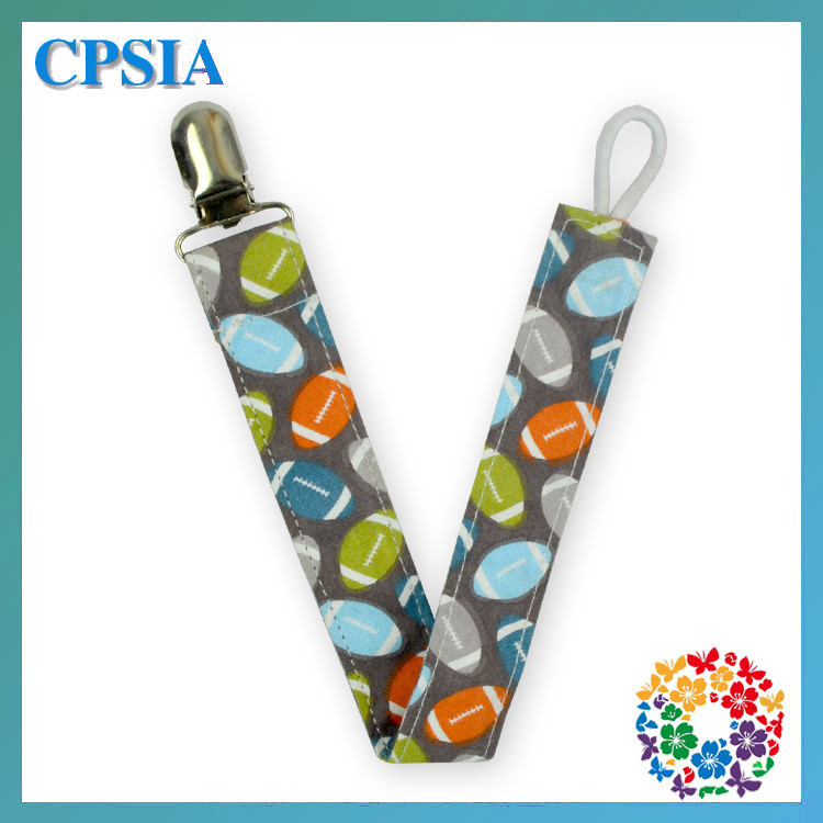 2015 newest football printed baby pacifier hanging clips baby pacifier clip