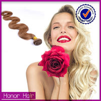 Top sale alibaba unprocessed remy honey hair weaving extension, brazilian hair weave blonde and brown