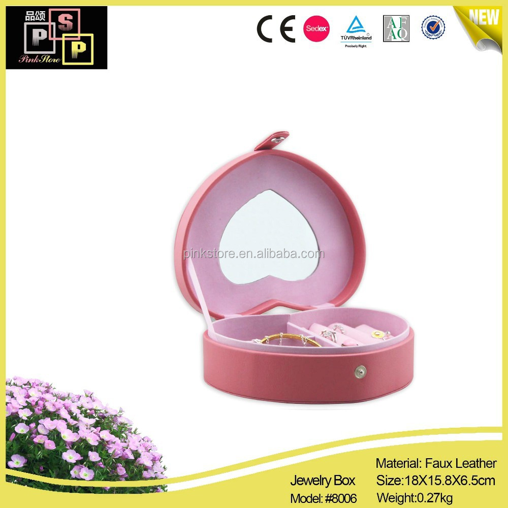 Heart shaped pink leather jewelry box with mirror