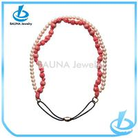 Coral color fabric covered pearl necklace strands