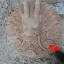 stone wall mounted dragon head water fountain