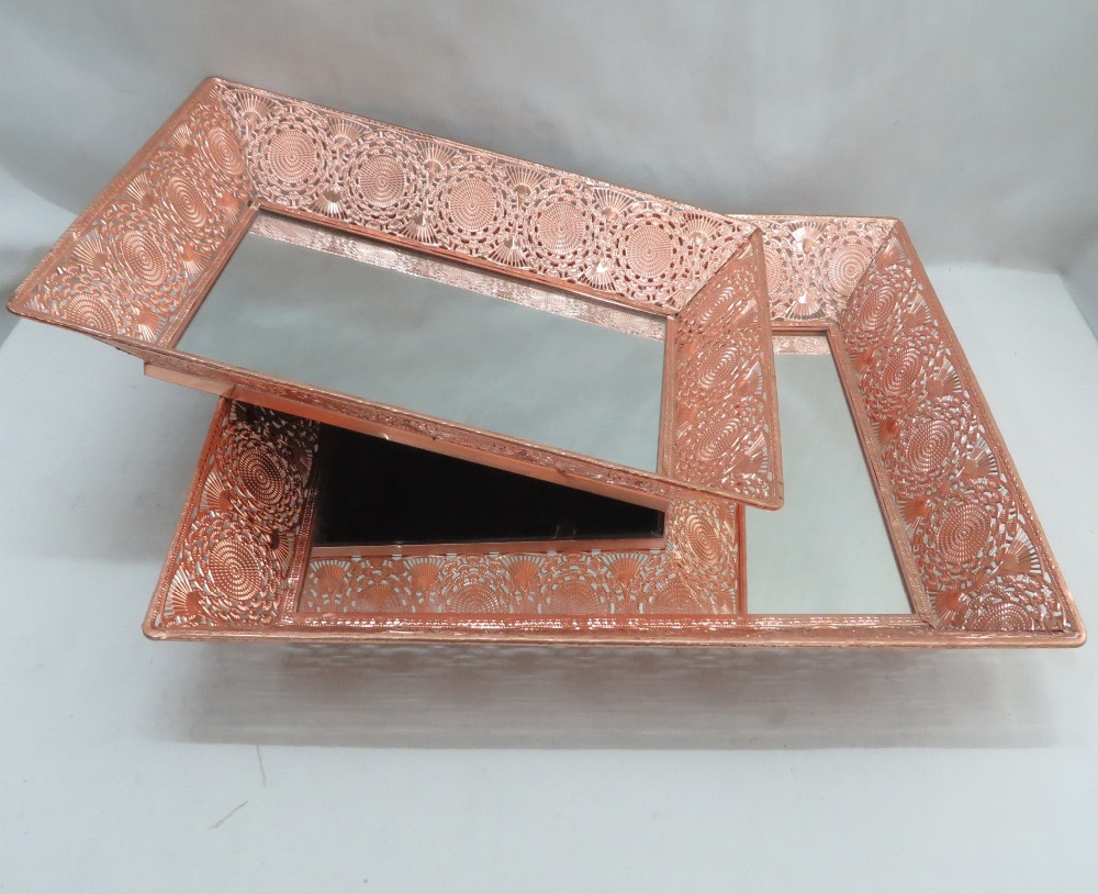 Rose gold metal serving tray with mirror