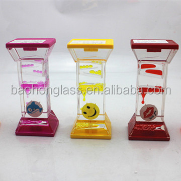 Factory price novelty crafts flowing colored liquid hour glass