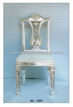 royal carved silver dining table and dining chair set (silver