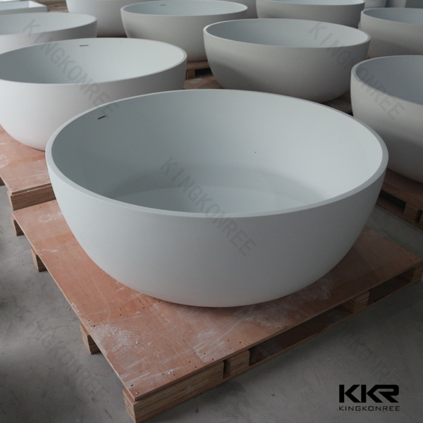 KKR acrylic stone bathtub freestanding against wall