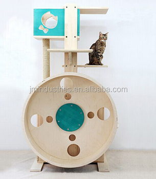 cat tower with exercise wheel and playing boxes