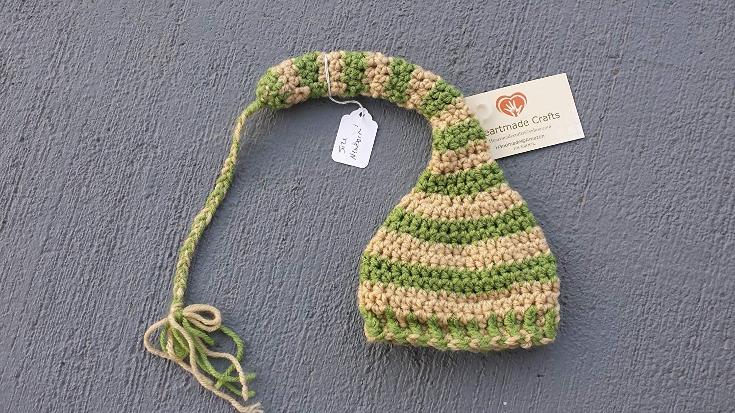 8c3084d1f02 Get Quotations · Elf style braided tail stocking hat for baby. SIZE newborn.  Green and cream.
