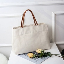 Nuovo Stile <span class=keywords><strong>di</strong></span> estate 2019 Tote In Bianco borsa <span class=keywords><strong>di</strong></span> Tela <span class=keywords><strong>di</strong></span> Cotone Borsa Da Spiaggia <span class=keywords><strong>sacchetti</strong></span> <span class=keywords><strong>di</strong></span> <span class=keywords><strong>Mano</strong></span> <span class=keywords><strong>Delle</strong></span> <span class=keywords><strong>Signore</strong></span> Con Manico In Pelle <span class=keywords><strong>Delle</strong></span> Borse <span class=keywords><strong>Delle</strong></span> Donne <span class=keywords><strong>di</strong></span> Basso MOQ