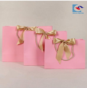 wholesale luxury pink cardboard gift paper bags with gold ribbon and rope