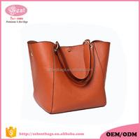 Custom famous brand designer free embossed logos pu tote bag lady leather handbag