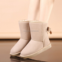 Slip resistant rubber sole long tall fur boots outside