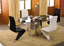 Stainless tube legs with round tempered glass top Dining Table