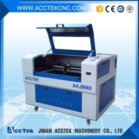 AKJ6090 High Speed Laser Engraving & Cutting Mobile Phone Tempered Glass Screen Protector Machine