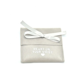 Small jewelry flap pouch with ribbon bow knot closure