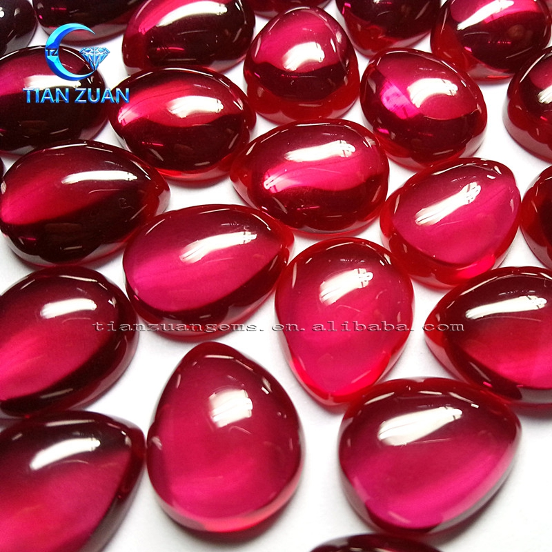 Pear shape synthetic ruby or corundum pigeon-blood red cabochon gemstone