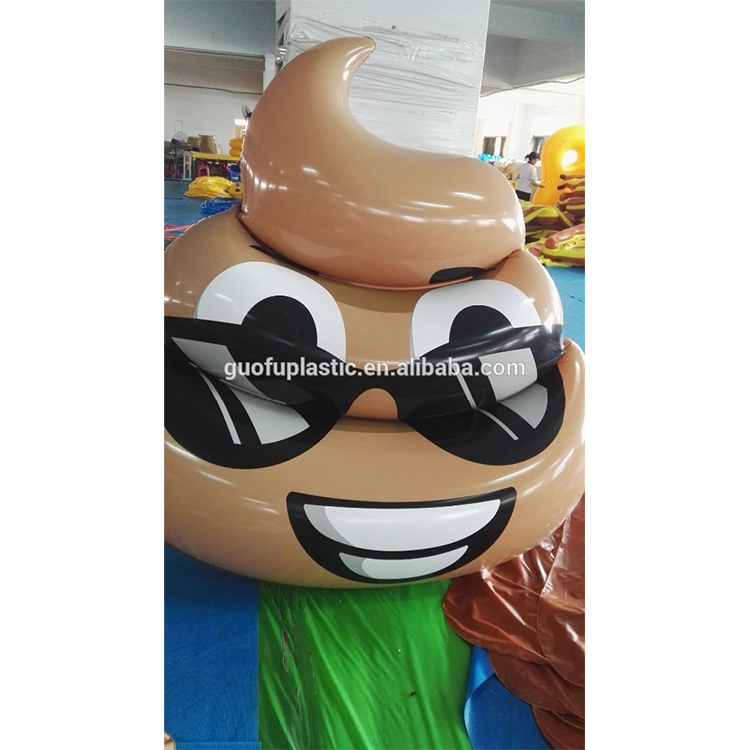 inflatable shit boy with glasses