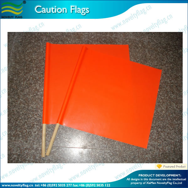 orange safety wooden hand flag